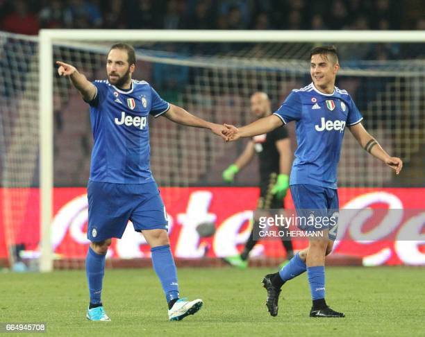 Juventus' forward from Argentina Gonzalo Higuain celebrates with teammate Juventus' forward from Argentina Paulo Dybala after scoring during the Tim...