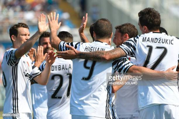 Juventus' forward from Argentina Gonzalo Higuain celebrates with teammates after scoring during the Italian Serie A football match Pescara versus...