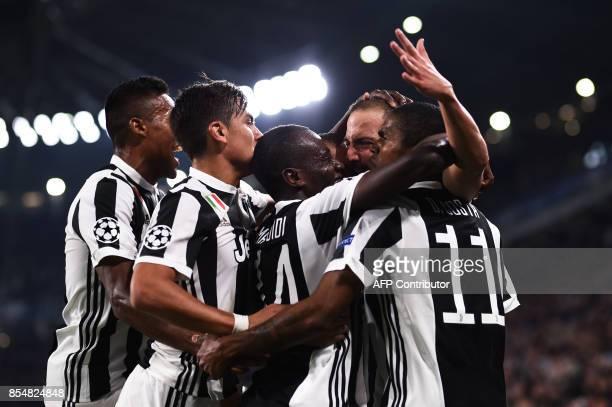 Juventus' forward from Argentina Gonzalo Higuain celebrates with teammates Juventus' defender from Brazil Alex Sandro Juventus' forward from...