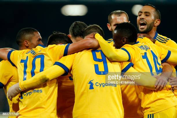 Juventus' forward from Argentina Gonzalo Higuain celebrates with teammates after scoring during the Italian Serie A football match Napoli vs Juventus...
