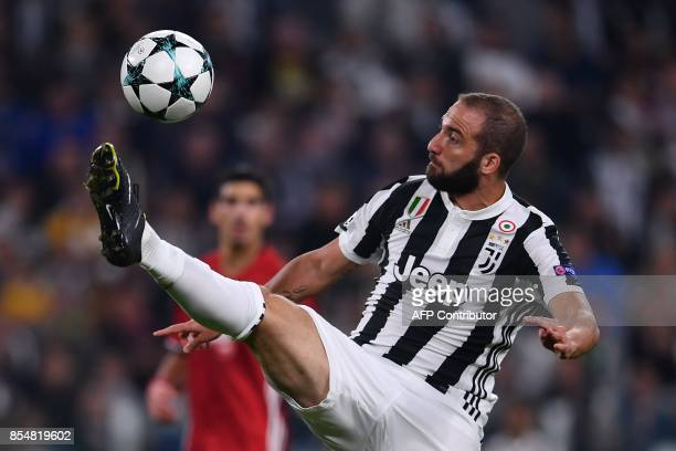 Juventus' forward from Argentina Gonzalo Higuain controls the ball during the UEFA Champion's League Group D football match Juventus vs Olympiacos on...