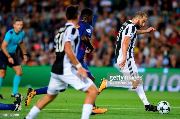 Juventus' forward from Argentina Gonzalo Higuain drives the ball during the UEFA Champions League Group D football match FC Barcelona vs Juventus at...