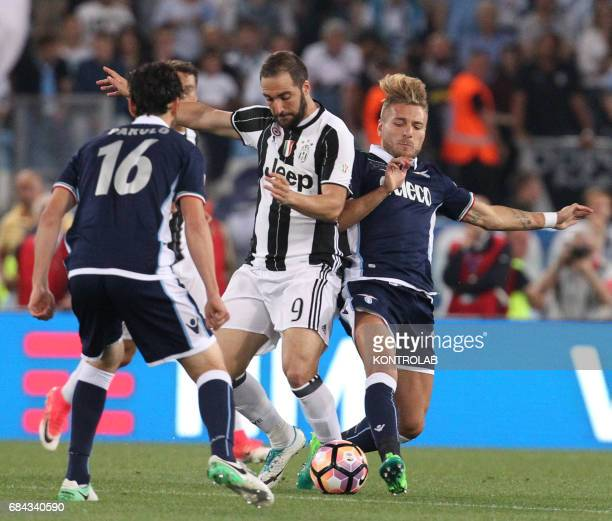 Juventus' forward from Argentina Gonzalo Higuain fights for the ball with Lazio's forward from Italy Ciro Immobile and Lazio's midfielder from Italy...