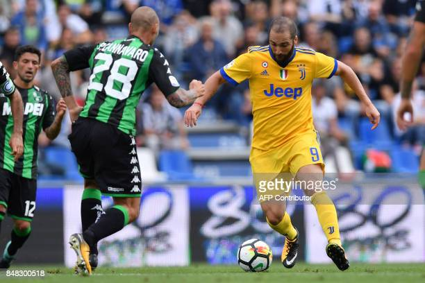 Juventus' forward from Argentina Gonzalo Higuain fights for the ball Sassuolo's defender from Italy Paolo Cannavaro during the Italian Serie A...