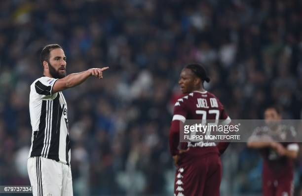 Juventus' forward from Argentina Gonzalo Higuain gestures during the Italian Serie A football match Juventus vs Torino FC at the Juventus stadium in...