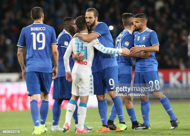 Juventus' forward from Argentina Gonzalo Higuain greets Napoli's Belgian forward Dries Mertens at the end of the Italian Serie A football match SSC...