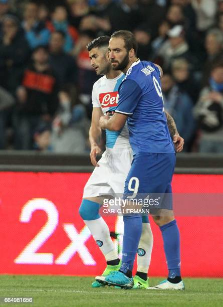 Juventus' forward from Argentina Gonzalo Higuain greets Napoli's Albanian defender Elseid Hysaj at the end of the Tim Cup semifinal second leg...