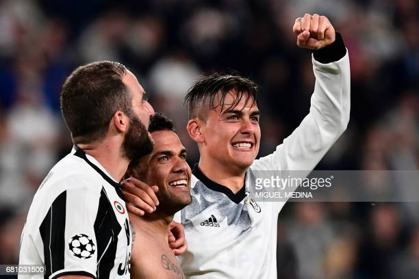Juventus' forward from Argentina Gonzalo Higuain Juventus Defender from Brazil Dani Alves and Juventus' forward from Argentina Paulo Dybala celebrate...