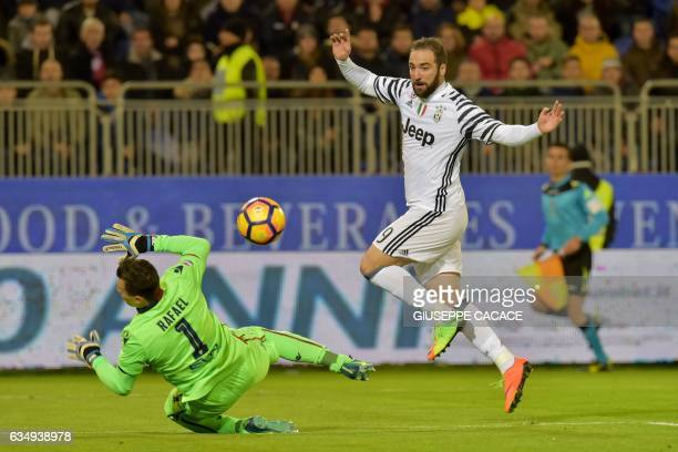 Juventus' forward from Argentina Gonzalo Higuain kicks to score a goal during the Italian Serie A football match between Cagliari and Juventus at...