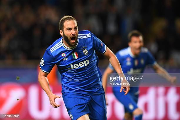 Juventus' forward from Argentina Gonzalo Higuain reacts after scoring a goal during the UEFA Champions League semifinal first leg football match...
