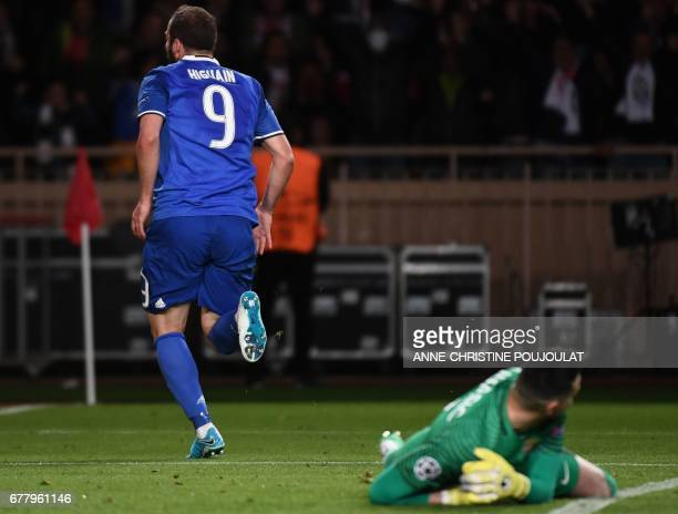Juventus forward from Argentina Gonzalo Higuain reacts after scoring a goal during the UEFA Champions League semifinal first leg football match...