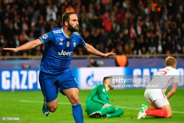 Juventus' forward from Argentina Gonzalo Higuain reacts after scoring a second goal during the UEFA Champions League semifinal first leg football...