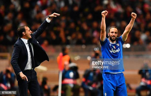 Juventus forward from Argentina Gonzalo Higuain reacts after scoring the team's second goal next to Juventus' Italian head coach Massimiliano Allegri...