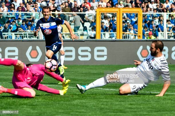 Juventus' forward from Argentina Gonzalo Higuain scores during the Italian Serie A football match Pescara versus Juventus at Adriatico's comunal...