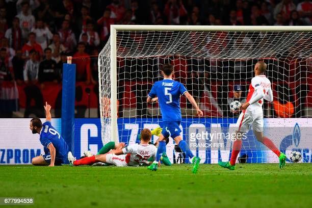 Juventus' forward from Argentina Gonzalo Higuain scores his team's second goal during the UEFA Champions League semifinal first leg football match...