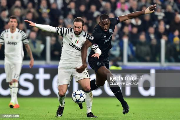 Juventus' forward from Argentina Gonzalo Higuain vies with Porto's French defender Willy Boly during the UEFA Champions League football match...