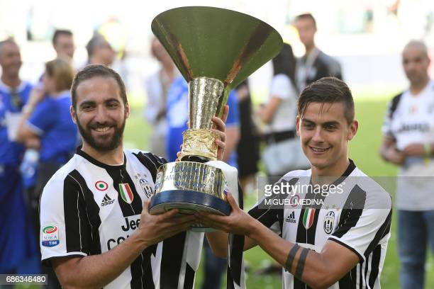 Juventus' forward from Argentina Paulo Dybala and Juventus' forward from Argentina Gonzalo Higuain pose with the trophy after winning the Italian...