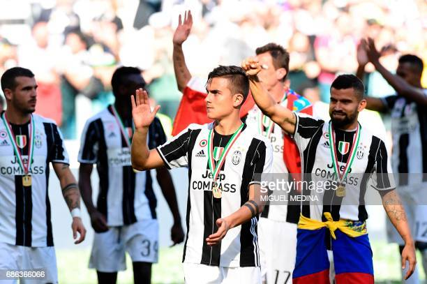 Juventus' forward from Argentina Paulo Dybala and Juventus midfielder from Venezuela Tomas Rincon greet fans after winning the Italian Serie A...