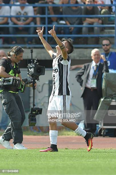 Juventus' forward from Argentina Paulo Dybala celebrates after scoring during the Italian Serie A football match Empoli vs Juventus on October 2 2016...