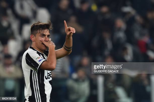 Juventus' forward from Argentina Paulo Dybala celebrates after scoring a goal during the Italian Serie A football match between Juventus and Palermo...