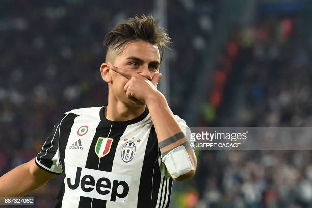 Juventus' forward from Argentina Paulo Dybala celebrates after scoring during the UEFA Champions League quarter final first leg football match...