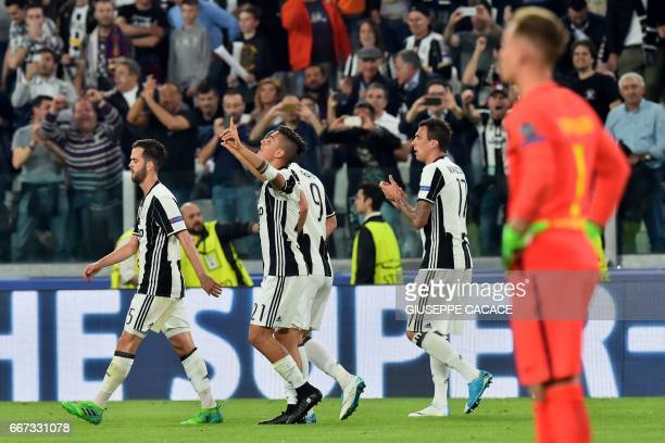 Juventus' forward from Argentina Paulo Dybala celebrates with teammates after scoring a second goal during the UEFA Champions League quarter final...