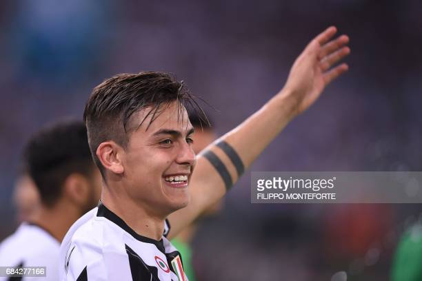 Juventus' forward from Argentina Paulo Dybala celebrates with teammates after winning the Italian Tim Cup final on May 17 2017 at the Olympic stadium...