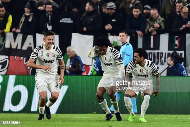 Juventus' forward from Argentina Paulo Dybala celebrates with teammates Juventus' forward from Colombia Juan Cuadrado and Juventus Defender from...