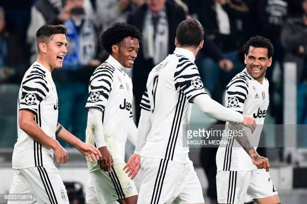 Juventus' forward from Argentina Paulo Dybala celebrates with teammates Juventus' forward from Colombia Juan Cuadrado Juventus' forward from...