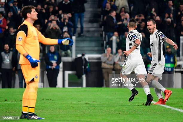 Juventus' forward from Argentina Paulo Dybala celebrates with Juventus' defender from Italy Leonardo Bonucci after scoring a penalty against Porto's...