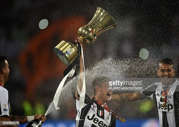 Juventus' forward from Argentina Paulo Dybala celebrates with the trophy after winning the Italian Tim Cup final football match AC Milan vs Juventus...