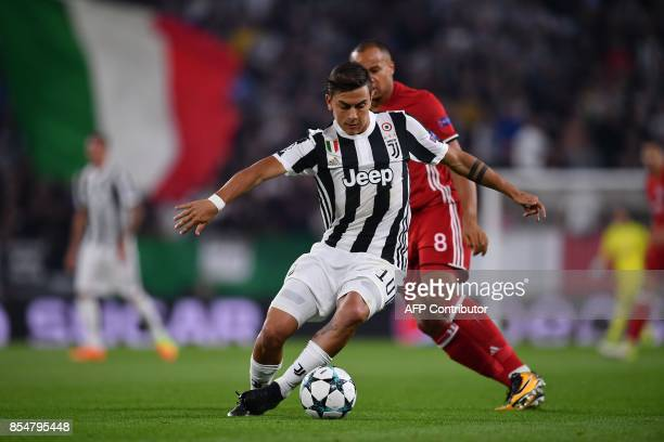 Juventus' forward from Argentina Paulo Dybala controls the ball during the UEFA Champion's League Group D football match Juventus vs Olympiacos on...