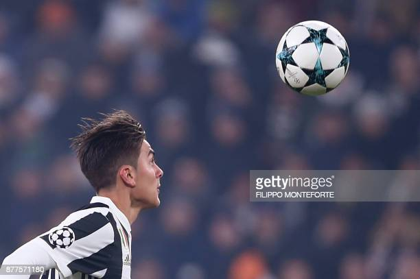 Juventus' forward from Argentina Paulo Dybala eyes the ball during the UEFA Champions League Group D football match Juventus Barcelona on November 22...