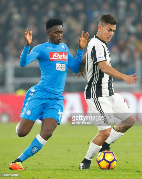 Juventus' forward from Argentina Paulo Dybala fights for the ball with Napoli's Guinean midfielder Amadou Diawara during the first leg semifinal of...