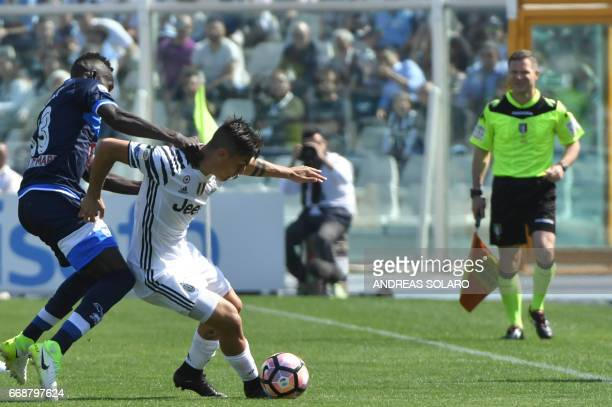 Juventus' forward from Argentina Paulo Dybala fights for the ball with Pescara's midfielder from Ivory Coast Coulibaly Mamadou the Italian Serie A...