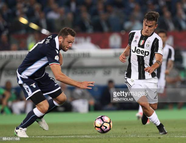 Juventus' forward from Argentina Paulo Dybala fights for the ball with Lazio's defender from the Netherlands Stefan de Vrij during the TIM Italy Cup...