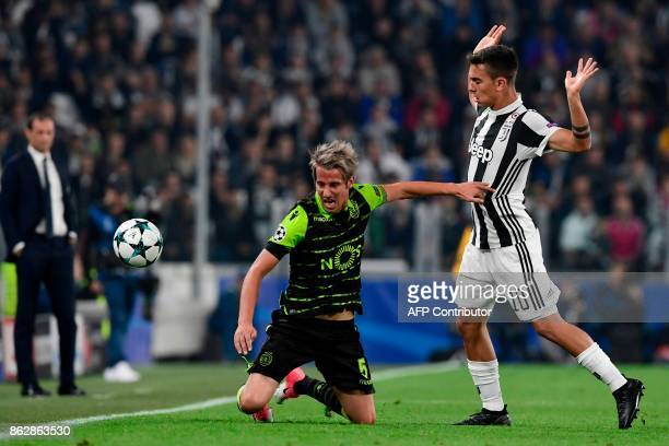 Juventus' forward from Argentina Paulo Dybala fights for the ball with Sporting's midfielder Fabio Coentrao during the UEFA Champions League Group D...