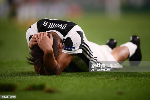 Juventus' forward from Argentina Paulo Dybala reacts during the UEFA Champions League Group D football match Juventus vs Sporting CP at the Juventus...