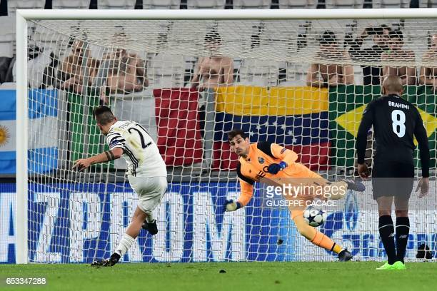 TOPSHOT Juventus' forward from Argentina Paulo Dybala score a penalty against Porto's Spanish goalkeeper Iker Casillas during the UEFA Champions...