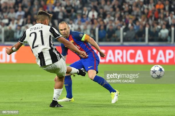 Juventus' forward from Argentina Paulo Dybala scores against Barcelona's midfielder Andres Iniesta during the UEFA Champions League quarter final...