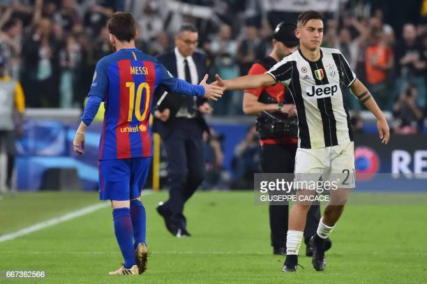 Juventus' forward from Argentina Paulo Dybala shakes hands with Barcelona's Argentinian forward Lionel Messi at the end of the UEFA Champions League...