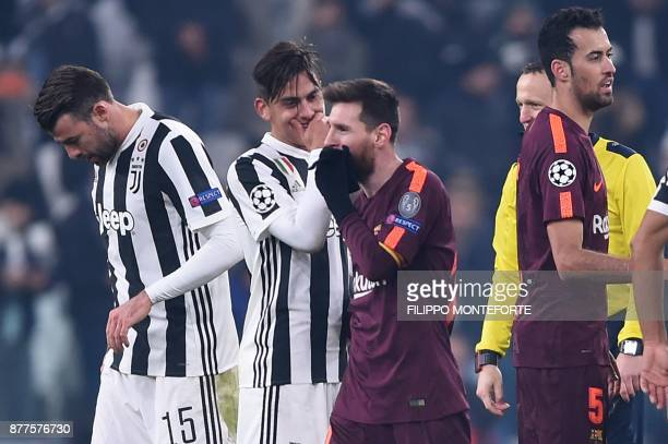 Juventus' forward from Argentina Paulo Dybala speaks to Barcelona's Argentinian forward Lionel Messi at the end of the UEFA Champions League Group D...