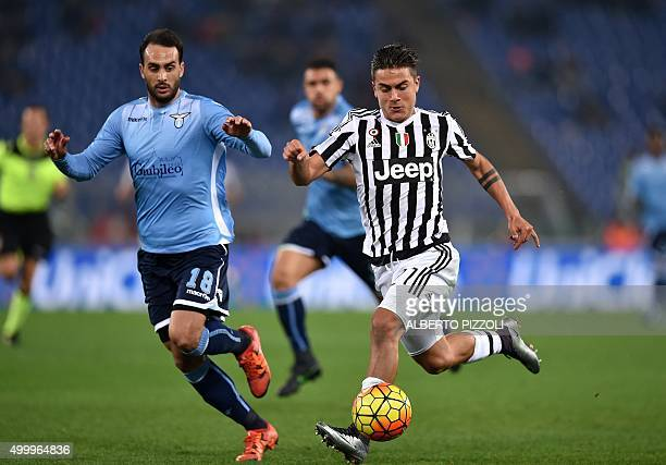 Juventus' forward from Argentina Paulo Dybala vies for the ball with Lazio's defender from Argentina Santiago Gentiletti during the Italian Serie A...