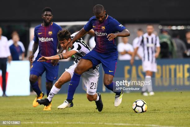 Juventus' forward from Argentina Paulo Dybala vies for the ball with Barcelona's defender Aleix Vidal during the International Champions Cup match...