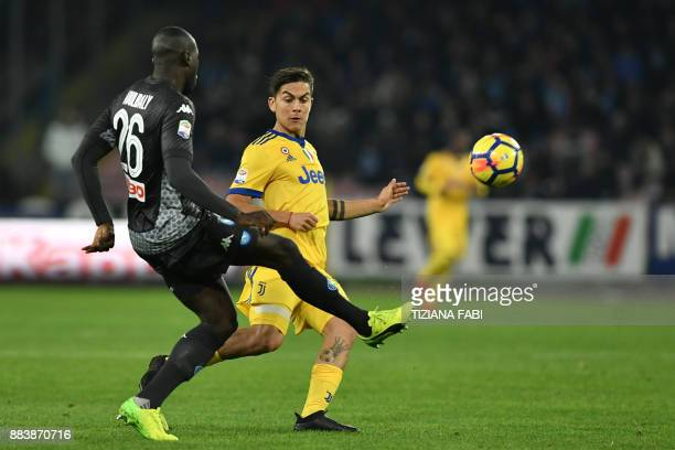 Juventus' forward from Argentina Paulo Dybala vies with Napoli's defender from France Kalidou Koulibaly during the Italian Serie A football match...