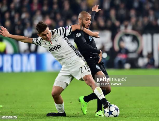 Juventus' forward from Argentina Paulo Dybala vies with Porto's Algerian midfielder Yacine Brahimi during the UEFA Champions League football match...