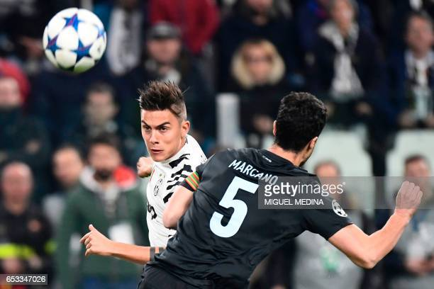 Juventus' forward from Argentina Paulo Dybala vies with Porto's Spanish defender Ivan Marcano during the UEFA Champions League football match...