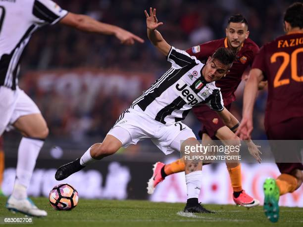Juventus' forward from Argentina Paulo Dybala vies with Roma's defender from Greece Kostas Manolas during the Italian Serie A football match Roma vs...