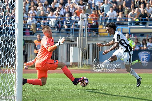 Juventus' forward from Colombia Juan Cuadrado tries to score against against Empoli's goalkeeper from Poland Lukasz Skorupski during the Italian...