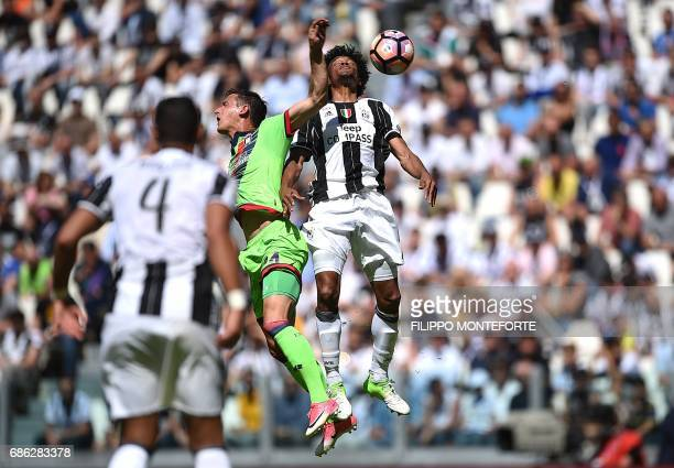 Juventus' forward from Colombia Juan Cuadrado vies with Crotone's midfielder from Bulgaria Aleksandar Tonev the Italian Serie A football match...